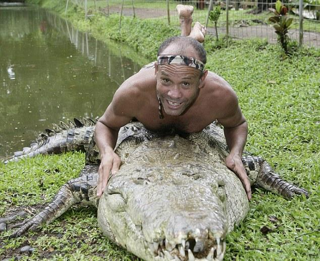 Man Named Chito Swims with 17-foot Crocodile